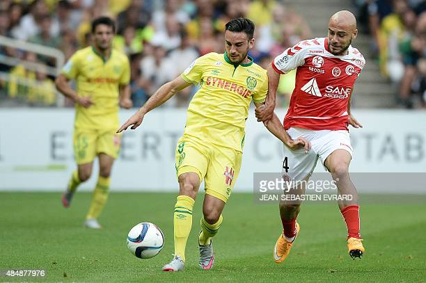 Nantes' French midfielder Adrien Thomasson vies with Reims' Georgian defender Jaba Kankava during the French L1 football match between Nantes and...