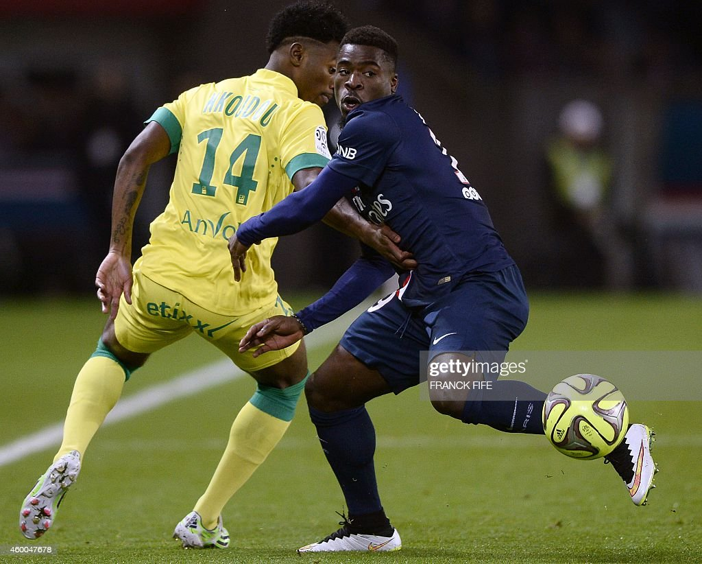 Nantes' French midfielder Georges Kevin Nkoudou (L) challenges Paris Saint-Germain's Ivorian defender Serge Aurier during the French L1 football match between Paris Saint-Germain (PSG) and Nantes at the Parc des Princes stadium in Paris on December 6, 2014.