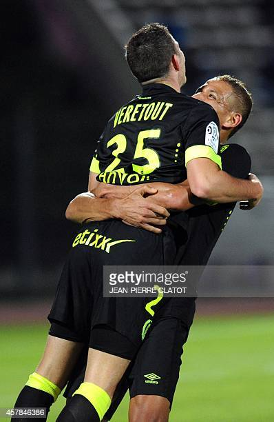 Nantes' French midfielder Jordan Veretout is congratulated by his teammate after scoring a goal during the French L1 football match between Evian...