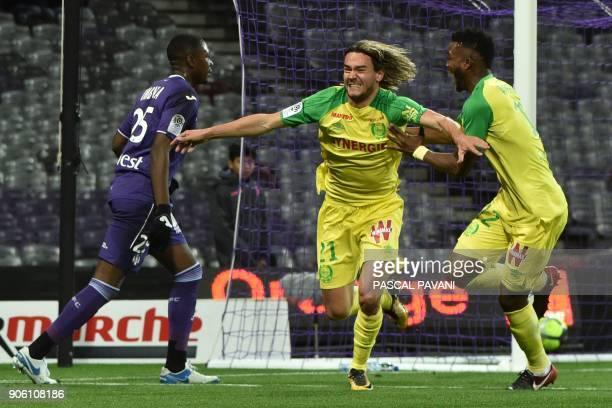 Nantes' French midfielder Rene Krhin celebrates with his teammates after scoring a goal during the French L1 football match Toulouse against Nantes...