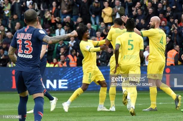 TOPSHOT Nantes' French midfielder Samuel Moutoussamy Nantes' Brazilian defender Diego Carlos Nantes' Portuguese defender Ie Edgar and Nantes' French...
