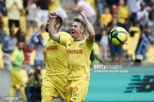 Nantes' French midfielder Valentin Rongier celebrates after scoring a goal during the French L1 football match between Nantes and Amiens at the La...