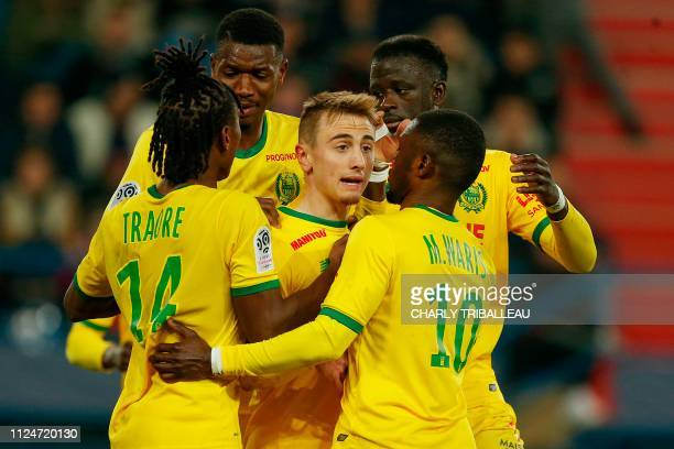 TOPSHOT Nantes' French midfielder Valentin Rongier jubilates with teammates after scoring a penalty kick during the French L1 football match between...