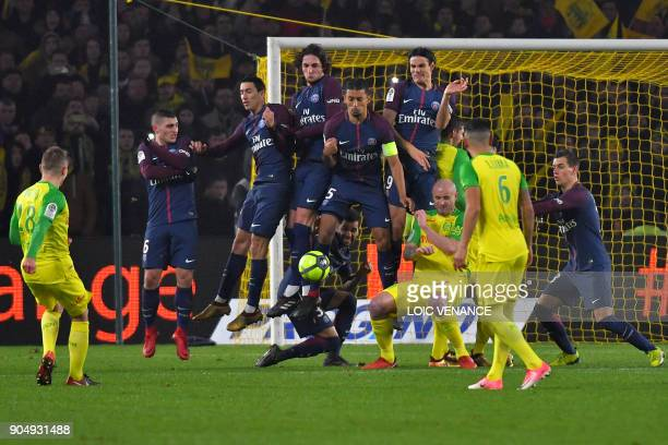Nantes' French midfielder Valentin Rongier kicks a free kick during the French L1 football match between Nantes and Paris SaintGermain at the La...
