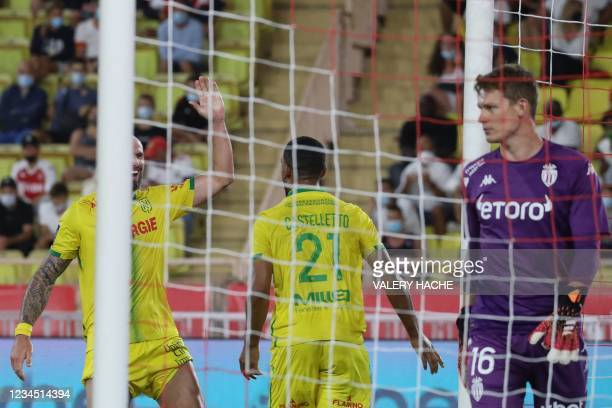 Nantes' French-Cameroonian defender Jean-Charles Castelletto celebrates with teammates after scoring his team's first goal during the French L1...