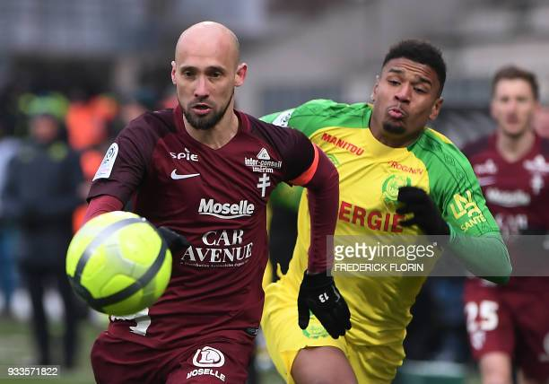 Nantes' FrenchSenegalese forward Santy Ngom vies with Metz' French midfielder Renaud Cohade during the French L1 football match Metz vs Nantes on...