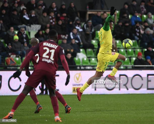 Nantes' FrenchSenegalese forward Santy Ngom vies withMetz' French defender Moussa Niakhate during the French L1 football match between Metz and...