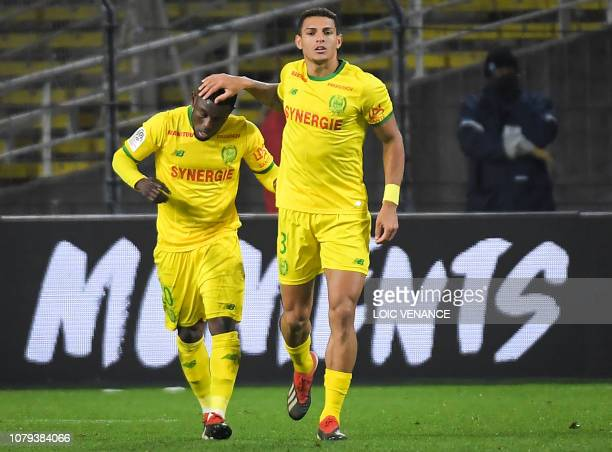 Nantes' Ghanaian forward Abdul Majeed Waris celebrates with teammate Brazilian defender Diego Carlos after scoring during the French L1 football...