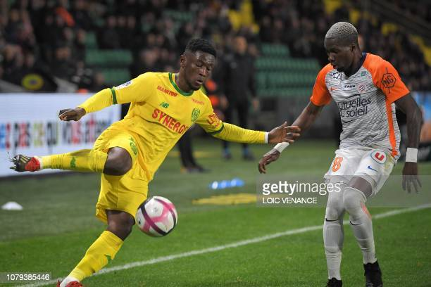 Nantes' Ghanaian forward Abdul Majeed Waris fights for the ball with Montpellier's Cameroon midfielder Ambroise Oyongo during the French L1 football...