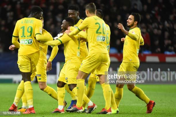 Nantes' Ghanaian forward Abdul Majeed Waris is congratulated by teammates after scoring a goal during the French League Cup round of 16 football...