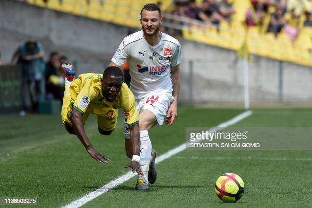 TOPSHOT Nantes' Ghanaian forward Waris Majeed vies for the ball with Amiens' Dutch defender Erik Pieters during the French L1 football match between...