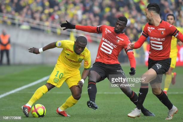 Nantes' Ghanean forward Majeed Waris vies for the ball with Rennes' Senegalese forward M'Baye Niang during the French L1 football match between...