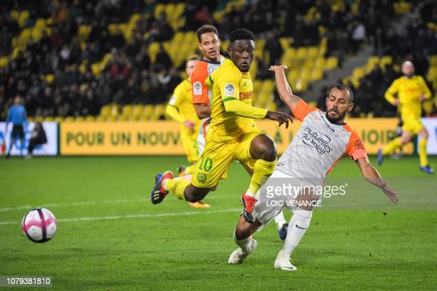 Nantes' Ghanean forward Majeed Waris vies with Montpellier's Brazilian defender Hilton during the French L1 football match Nantes vs Montpellier at...