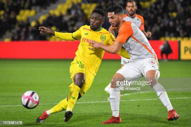 Nantes' Ghanean forward Majeed Waris vies with Montpellier's Portuguese defender Pedro Mendes during the French L1 football match Nantes vs...