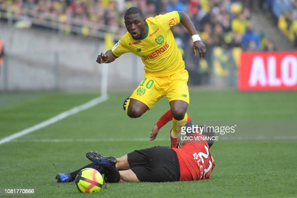 Nantes' Ghanean forward Majeed Waris vies with Rennes' French midfielder Benjamin Andre during the French L1 football match between Nantes and Rennes...