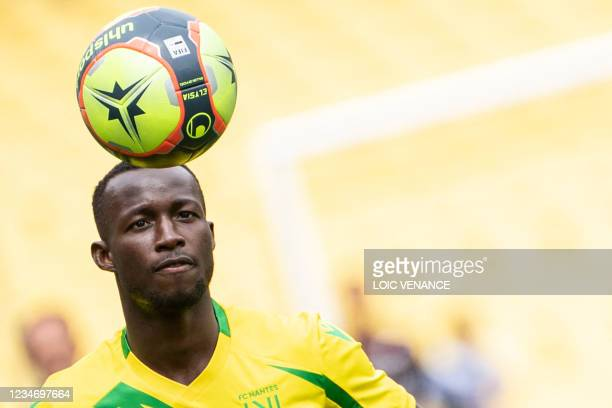 Nantes' Ghanean midfielder Osman Bukari warms up prior to the French L1 football match between FC Nantes and FC Metz at the La Beaujoire Stadium in...