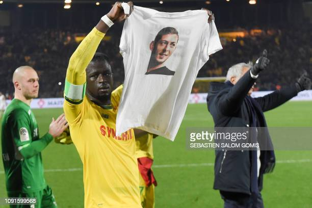 Nantes' Guinean defender Abdoulaye Toure holds a teeshirt depicting Nantes' Argentinian forward Emilianio Sala during a tribute ceremony for Nantes'...