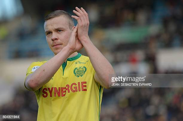 Nantes' Icelandic forward Kolbeinn Sigthorsson celebrates at the end of the French L1 football match between Nantes and SaintEtienne on January 10...