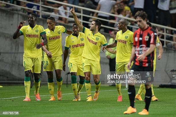 Nantes' Israeli forward Itay Shechter celebrates with teammates after scoring a goal during the French L1 football match between Nantes and Nice on...