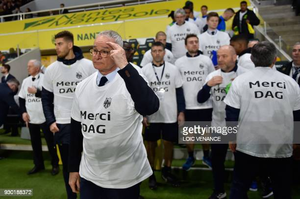 Nantes' Italian head coach Claudio Ranieri leads team staff members wearing jerseys paying homage to the former Nantes' team physiotherapist Philippe...
