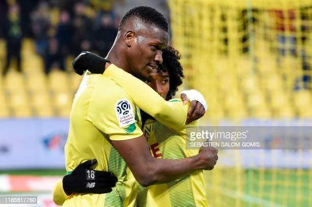 Nantes' Malian forward Kalifa Coulibaly and Nantes' French midfielder Samuel Moutoussamy celebrate after winning the French L1 football match between...