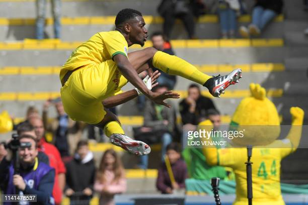 Nantes' Malian forward Kalifa Coulibaly celebrates after scoring a goal during the French L1 football match between Nantes and Dijon at the Beaujoire...