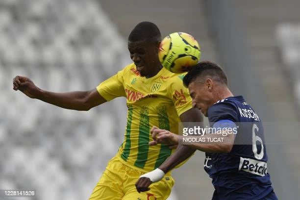 Nantes' Malian forward Kalifa Coulibaly fights for the ball with Bordeaux's French defender Laurent Koscielny during the French L1 football match...