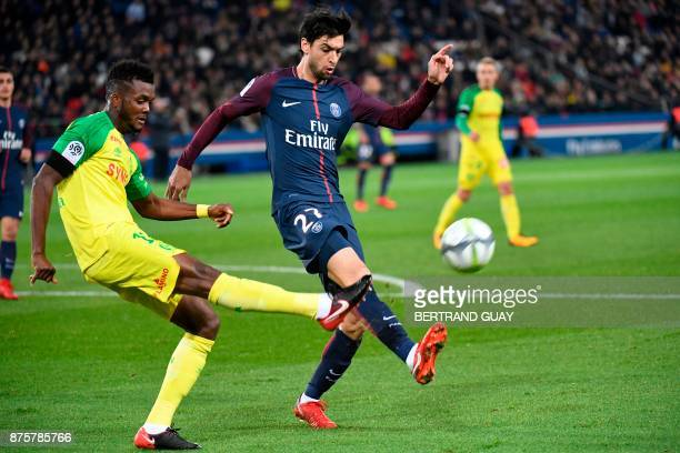 Nantes' Nigerian defender Chidozie Awaziem defends against Paris SaintGermain's Argentinian midfielder Javier Pastore during the French L1 football...