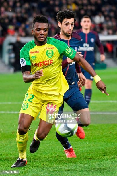 Nantes' Nigerian defender Chidozie Awaziem outruns Paris SaintGermain's Argentinian midfielder Javier Pastore during the French L1 football match...