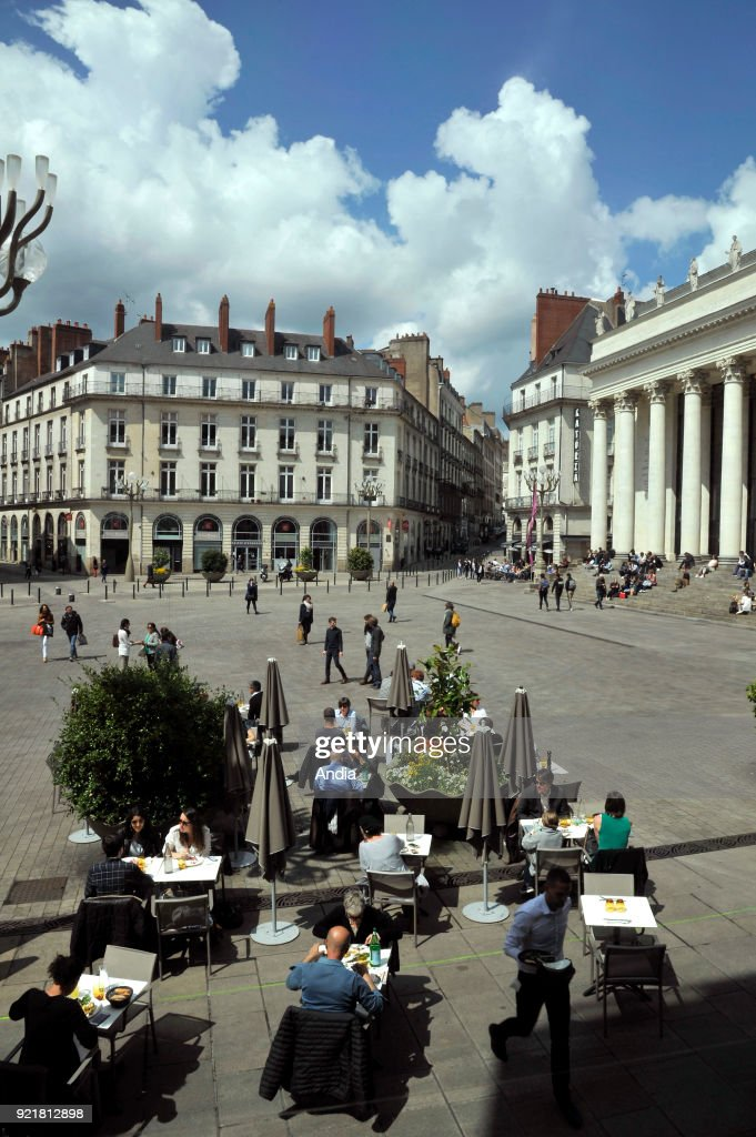 'place Graslin' square with the theatre and opera house Theatre Graslin and the terrace of a restaurant in the foreground.