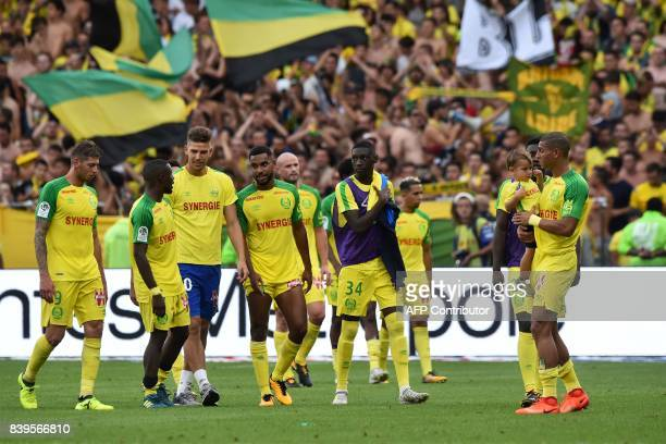 Nantes' players react after the French L1 football match between Nantes and Lyon on August 26 at the Beaujoire stadium of Nantes western France / AFP...