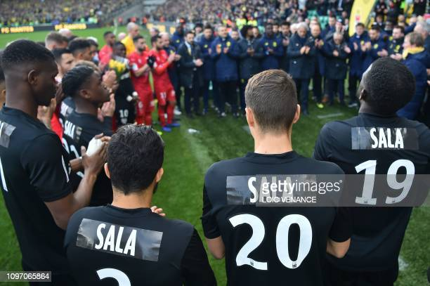 Nantes players staff members and Nantes' Bosnian head coach Vahid Halilhodzic pay tribute to late Argentinian forward Emiliano Sala prior to the...