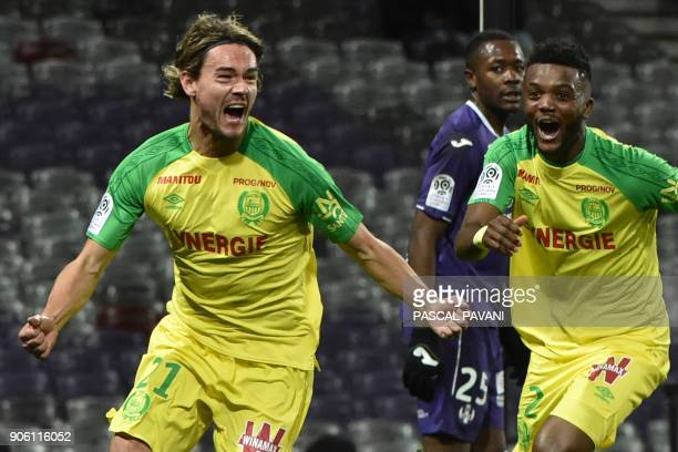 Nantes' Slovenian midfielder Rene Krhin celebrates with Nantes' Nigerian defender Chidozie Awaziem after scoring a goal during the French L1 football...