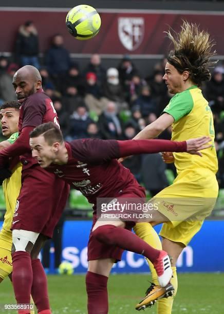 Nantes' Slovenian midfielder Rene Krhin vies with Metz' French forward Nolan Roux during the French L1 football match Metz vs Nantes on March 18 2018...