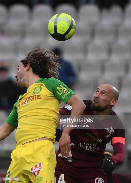 Nantes' Slovenian midfielder Rene Krhin vies with Metz' French midfielder Renaud Cohade during the French L1 football match Metz vs Nantes on March...