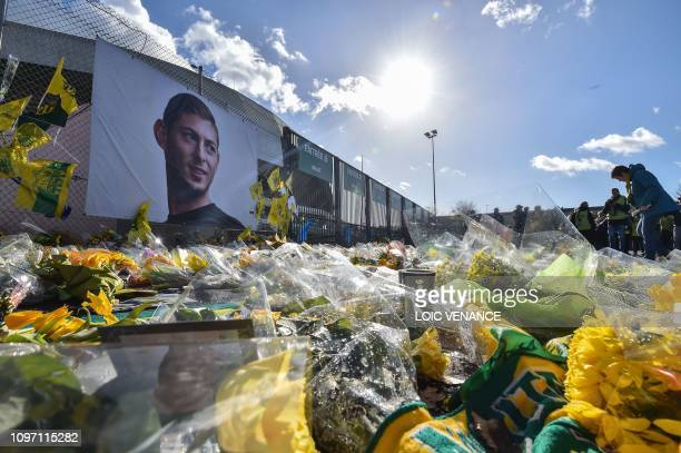 Nantes supporters gather in front of a portrait of late Argentinian forward Emiliano Sala prior to the French L1 football match between FC Nantes and...