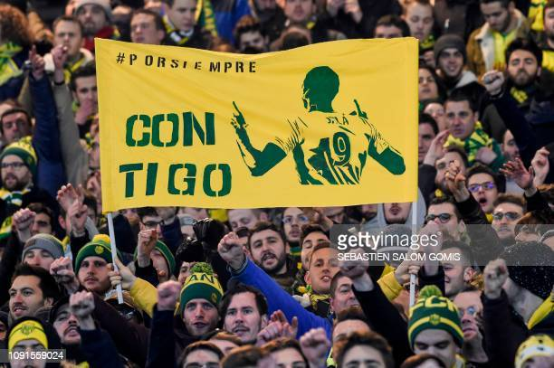 TOPSHOT Nantes supporters hold up a banner that reads 'With you' and showing the image of Nantes' Argentinian forward Emilianio Sala who is missing...