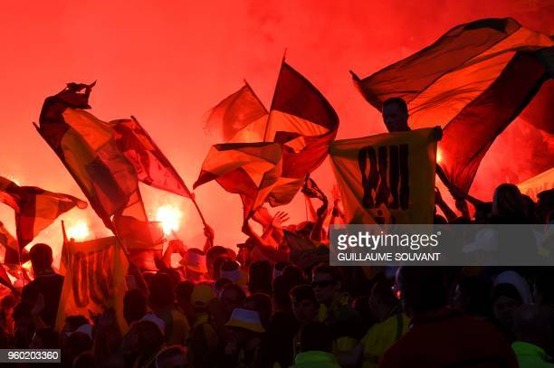 FC Nantes supporters wave flags during the French L1 football match between RC Strasbourg Alsace and Nantes FC at La Baujoire Stadium in Nantes...