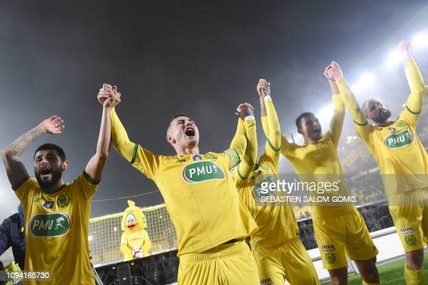 Nantes' team players celebrate at the end of the French Cup round of 16 football match between FC Nantes and Toulouse Football Club at the La...