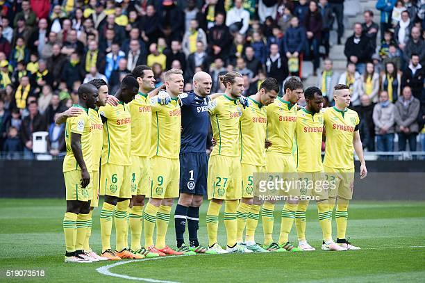 Nantes team respects a minute of silence in honor of victims of bombings of Brussels during the French League 1 match between Fc Nantes and Lille OSC...