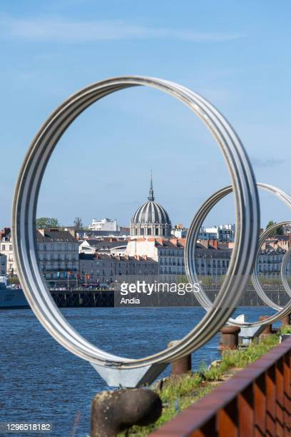 Nantes : The 'Rings' by Daniel Buren on the 'quai des Antilles' , along the Loire river on the ''ile de Nantes' . Overview of the city with the...