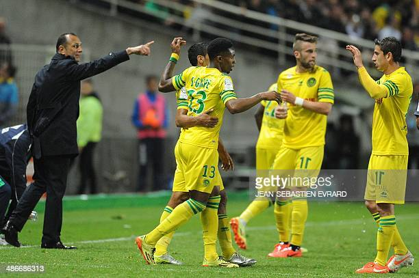 Nantes' Togolese forward Serge Gakpe celebrates after scoring a goal during the French L1 football between FC Nantes and Olympique Marseille on April...