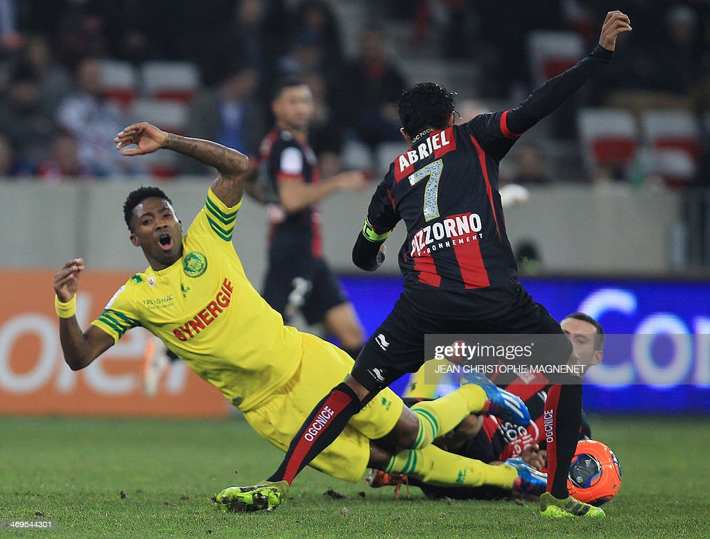 Nantes' Togolese forward Serge Gakpe (L) vies with Nice's French midfielder Fabrice Abriel (Top R) and Nice's French midfielder Mathieu Bodmer (Bottom R) during the French L1 football match between OGC Nice (OGCN) and FC Nantes (FCN) on February 15, 2014, at the Allianz Riviera stadium, in Nice, southeastern France.