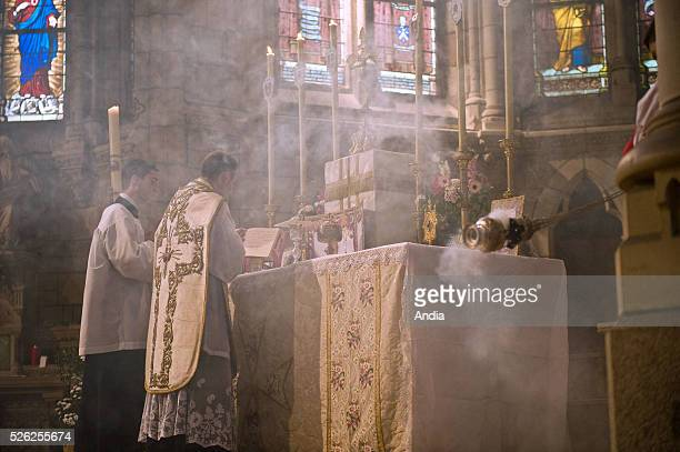 Nantes Traditionalist mass at the chapel of the secondary / hisgh school Lycee Saint Stanislas Priest choirboy censer and smoke
