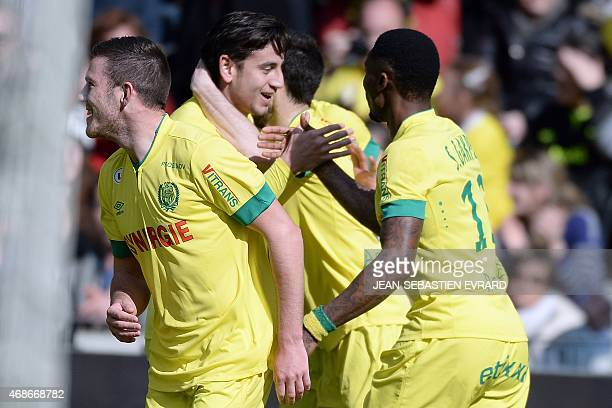 Nantes' US midfielder Alejandro Bedoya celebrates with teammates after scoring a goal during the French L1 football match between Nantes and Caen on...
