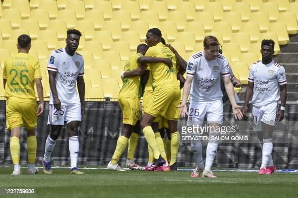 Nantes's players celebrate after scoring a goal during the French L1 football match between FC Nantes and Girondins de Bordeaux at the La Beaujoire...