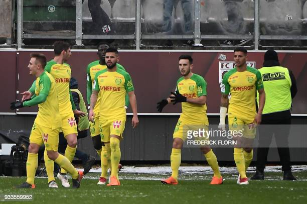 Nantes's players jubilate after scoring during the French L1 football match Metz vs Nantes on March 18 2018 at the SaintSymphorien stadium in...