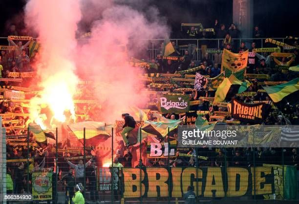 FC Nantes's supporters cheer during the French League Cup football match between Nantes and Tours at the Vallee du Cher stadium in Tours on October...