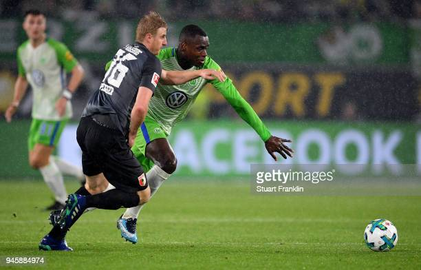 Nany Dimata of Wolfsburg and Martin Hinteregger of Augsburg battle for the ball during the Bundesliga match between VfL Wolfsburg and FC Augsburg at...