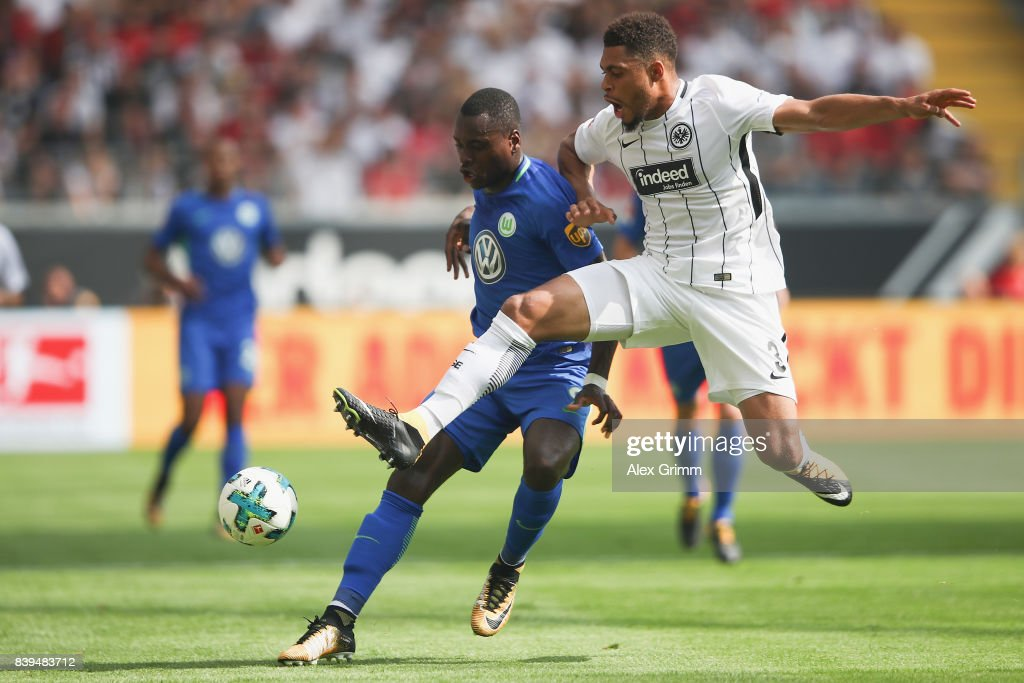 Nany Dimata (L) of Wolfsburg is challenged by Simon Falette of Frankfurt during the Bundesliga match between Eintracht Frankfurt and VfL Wolfsburg at Commerzbank-Arena on August 26, 2017 in Frankfurt am Main, Germany.